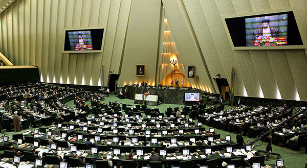 epa03823138 A general view of the parliament during the parliament session on 13 August 2013 in Tehran, Iran. Iranian president Hassan Rowhani proposed his cabinet to the parliament on 12 August 2013. All designated ministers need the majority votes of the 290 deputies before taking office. Rowhani said that his government will take distance from any form of extremism and rather adopt a moderate approach for ending the country?s international isolation.  EPA/ABEDIN TAHERKENAREH
